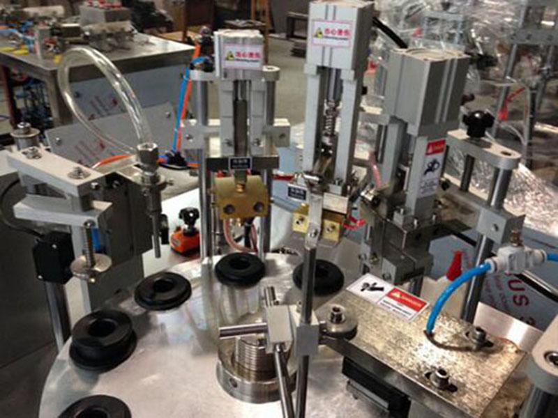 金属软管灌装封尾机基本工作原理及组成结构